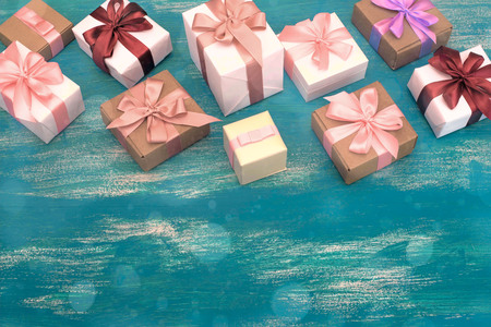 Festive composition Wooden vintage shabby background gift boxes with gifts. Top view Copy space for your text or design Stockfoto