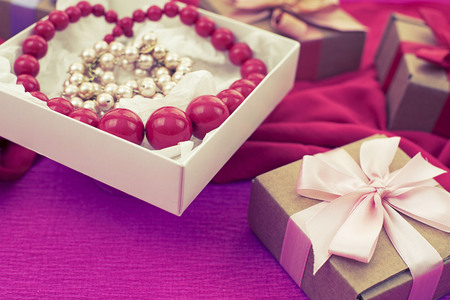 Decorative composition preparation for the holiday Decoration gifts. Purchase a Set of womens jewelry. Blurred background