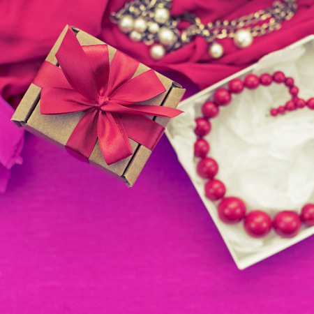Decorative composition preparation for the holiday Decoration gifts. Purchase a Set of women's jewelry. Blurred background. Square