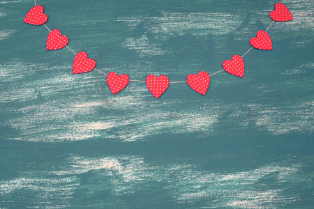 Wooden vintage shabby background with Festive garland of hearts. Top view Copy space for your text or design