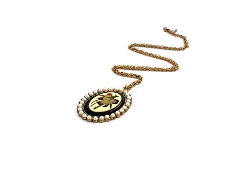 Necklace and pendants isolated on white background. Women's jewelry.