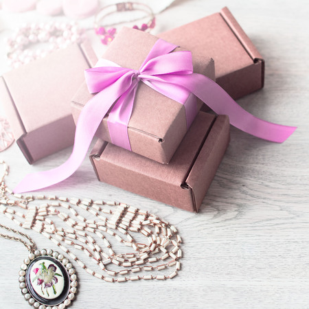 Accessories set for women, wooden light background. Buying women gifts, garments scarves, jewelry, haberdashery