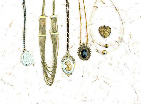 Great set of jewelry for women. Beautiful necklaces, earrings with feathers.