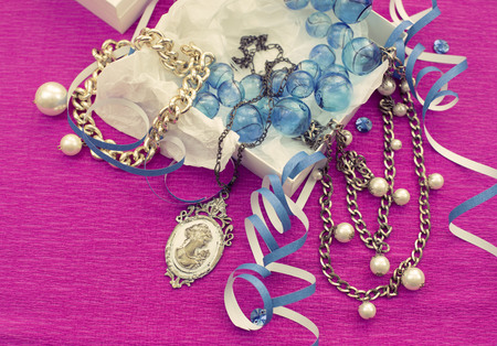 The decorative composition is Packed in a gifts box for women. Beautiful jewelry Chain Necklace Cameo Vintage style.