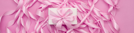 Banner Decorative holiday gift boxes with pink color on pink background. Flat flat top view