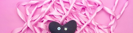 Banner delicate texture of satin ribbons of pink color. Heart of blue.Textured background Flat lay top View 版權商用圖片