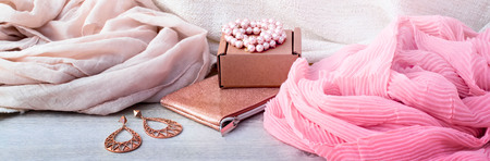 Banner Accessories set for women, wooden light background. Buying women gifts, garments scarves, jewelry, haberdashery
