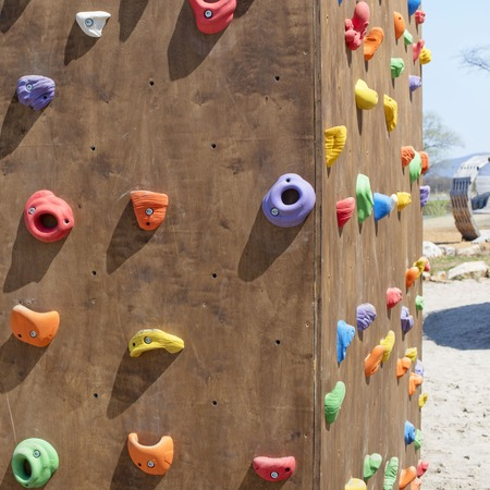 Wooden wall for climbing close up. Sports extreme multicolored background Banco de Imagens