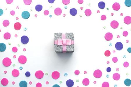Colored confetti box gift on a white background.