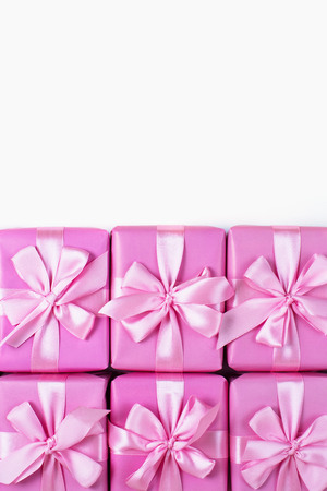 Rows of boxes six with gifts decoration ribbon satin bow pink. A top view of Flat lay Stock Photo