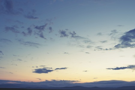 Cumulus clouds of the sunset with the sunset. Blue sky blurred background defocusing 版權商用圖片