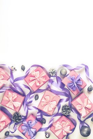 Christmas boxes with gifts on the occasion of pink