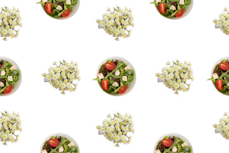 Cup with vegetable salad and chrysanthemum flowers on white isolated background Top view flat lay pattern