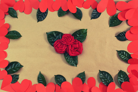 Frame of red hearts green leaves background for text. The concept of Valentine's day