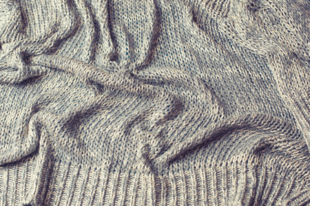 Knitted texture  gray. Abstract toned Imagens