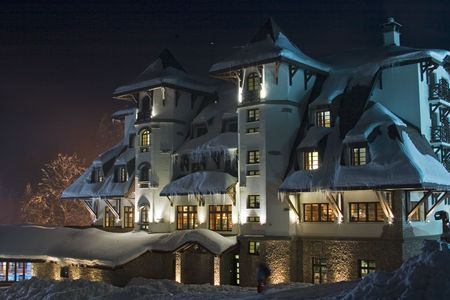 Nightshot of snow-covered ski-resort hotel  photo