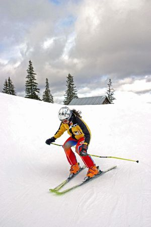 icily: Little girl skiing on a slope Stock Photo