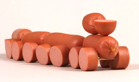 Little toy-train made of meat sausage photo