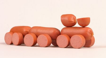 boiled sausage: Little toy-train made of meat sausage Stock Photo