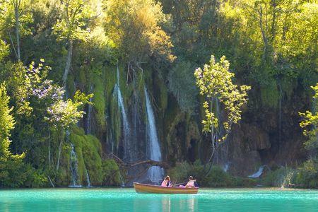 Close look at the waterfalls from a boat, lake Kozjak, Plitvice national park, Croatia photo