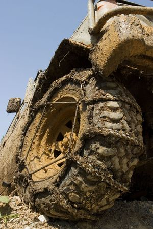 fourwheeldrive: Muddy wheel close-up on a vehicle participating in off-road challenge Stock Photo