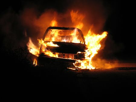 jeopardy: Car burning, nightshot Stock Photo