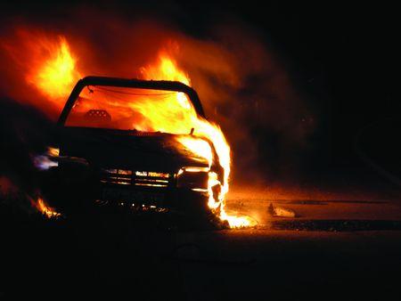 Car burning, nightshot photo