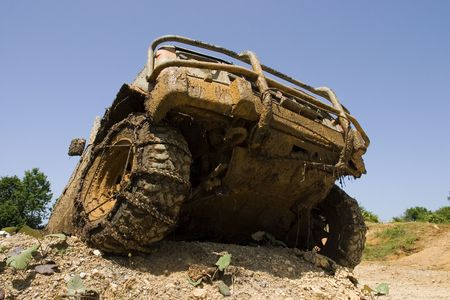 fourwheeldrive: Close-up on a front end of  all-terrain vehicle participating in off-road challenge Stock Photo