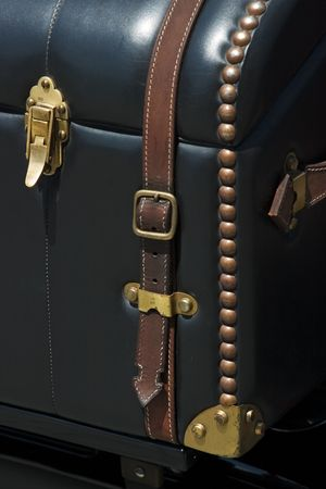 duffel: Detail of vintage leather travel trunk with rivets