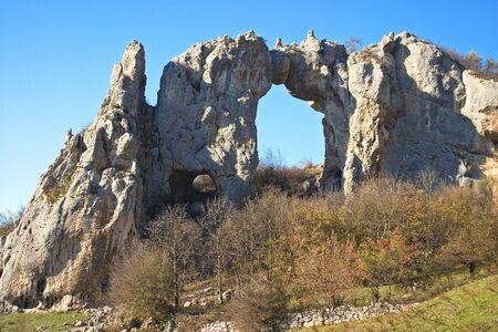 republika: Stone arch on a top of the hill, Republika Srpska, Bosnia Stock Photo
