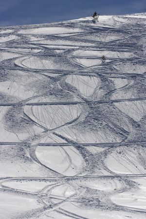 republika: Leftover from skiing, multiple tracks visible on the slope from previous day Stock Photo