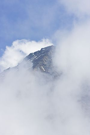 mountainside: Early morning fog rising from mountain peaks in Austrian Alps