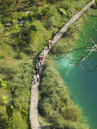 new path: Tourists walking around Plitvice lakes national park, Croatia Stock Photo