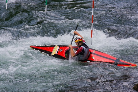 competes: BANJA LUKA, BOSNIA AND HERZEGOVINA - JULY 16: An unidentified athlete from GERMANY competes at European Junior and U23 Canoe Slalom Championships on July 16, 2011 in Banja Luka, Bosnia and Herzegovina. The event is from July 14-17, 2011.