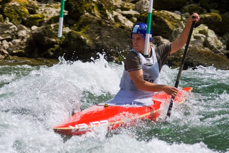 competes: BANJA LUKA, BOSNIA AND HERZEGOVINA - JULY 16: An unidentified athlete from Serbia competes at European Junior and U23 Canoe Slalom Championships on July 16, 2011 in Banja Luka, Bosnia and Herzegovina. The event is from July 14-17, 2011.