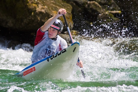 herzegovina: BANJA LUKA, BOSNIA AND HERZEGOVINA - JULY 16: An unidentified athlete from SWITZERLAND competes at European Junior and U23 Canoe Slalom Championships on July 16, 2011 in Banja Luka, Bosnia and Herzegovina. The event is from July 14-17, 2011.  Editorial