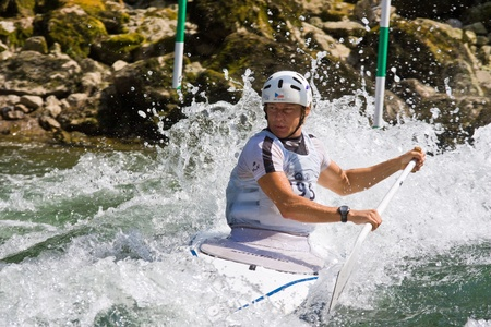 competes: BANJA LUKA, BOSNIA AND HERZEGOVINA - JULY 16: An unidentified athlete from Czech Republic competes at European Junior and U23 Canoe Slalom Championships on July 16, 2011 in Banja Luka, Bosnia and Herzegovina. The event is from July 14-17, 2011. Editorial