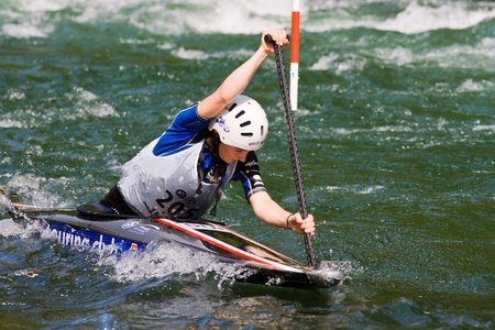 competes: BANJA LUKA, BOSNIA AND HERZEGOVINA - JULY 16: An unidentified athlete from SWITZERLAND competes at European Junior and U23 Canoe Slalom Championships on July 16, 2011 in Banja Luka, Bosnia and Herzegovina. The event is from July 14-17, 2011.  Editorial