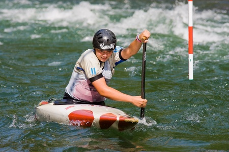 competes: BANJA LUKA, BOSNIA AND HERZEGOVINA - JULY 16: An unidentified athlete from Slovenia competes at European Junior and U23 Canoe Slalom Championships on July 16, 2011 in Banja Luka, Bosnia and Herzegovina. The event is from July 14-17, 2011.