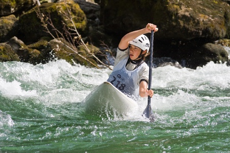 competes: BANJA LUKA, BOSNIA AND HERZEGOVINA - JULY 16: An unidentified athlete from Austria competes at European Junior and U23 Canoe Slalom Championships on July 16, 2011 in Banja Luka, Bosnia and Herzegovina. The event is from July 14-17, 2011.
