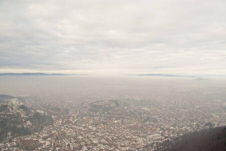 Winter big city Brasov scene in fog Stock Photo - 16726110