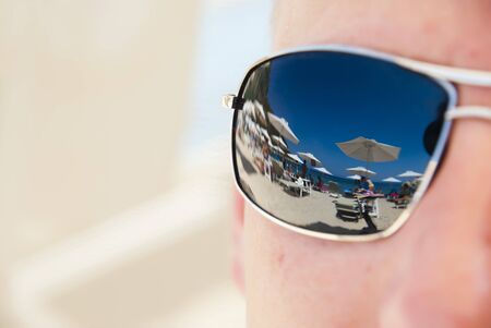 Reflection of a tropical resort in sunglasses  photo