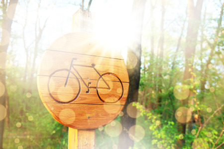 single lane road: Bicycle lane sign indicating bike route wooden Stock Photo