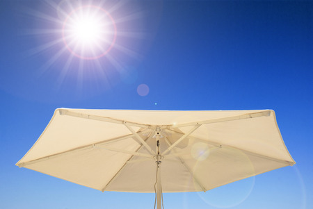 Cooling sun protection umbrella summer light Stock Photo