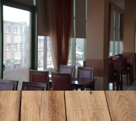 vintage wooden table on blurred cafe background dining room restaurant