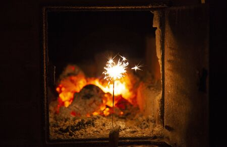 Bengal fire and sparks macro photo festive bokeh background Christmas and New Year Reklamní fotografie - 138071559