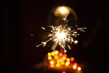 Bengal fire and sparks macro photo festive bokeh background Christmas and New Year Imagens