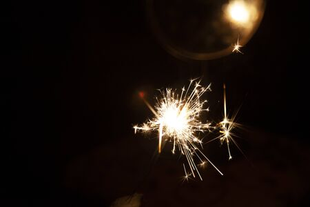 Bengal fire and sparks macro photo festive bokeh background Christmas and New Year Stock Photo