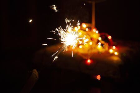 Bengal fire and sparks macro photo festive bokeh background Christmas and New Year Reklamní fotografie
