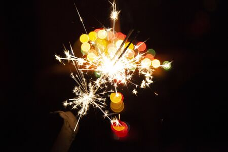 Bengal fire and sparks macro photo festive bokeh background Christmas and New Year Standard-Bild